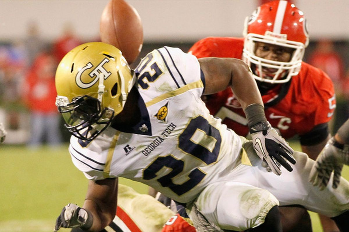 ATHENS GA - NOVEMBER 27:  Roddy Jones #20 of the Georgia Tech Yellow Jackets has the ball stripped behind him by the Georgia Bulldogs at Sanford Stadium on November 27 2010 in Athens Georgia.  (Photo by Kevin C. Cox/Getty Images)