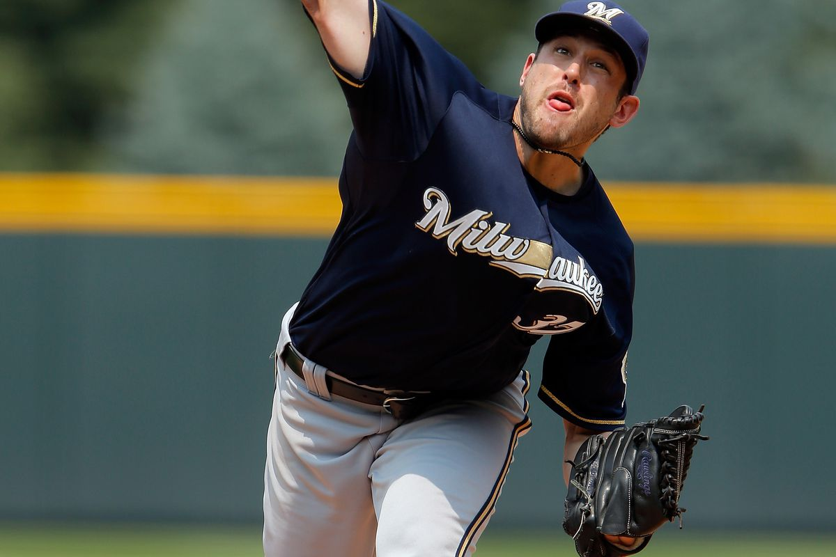 DENVER, CO - AUGUST 15:  Starting pitcher Mark Rogers #37 of the Milwaukee Brewers delivers against the Colorado Rockies at Coors Field on August 15, 2012 in Denver, Colorado.  (Photo by Doug Pensinger/Getty Images)