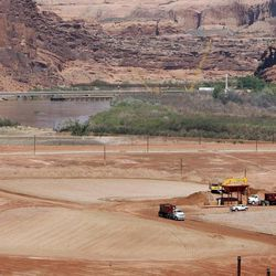 The Atlas uranium mill tailings site in Moab in the foreground and the Colorado River in the background. The tailing are being relocated 30 miles north to Crescent Junction. Monday, May 4, 2009.