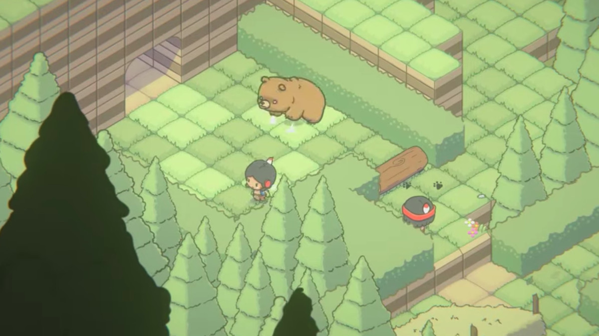 An isometric view of a player fighting a bear in a forest.