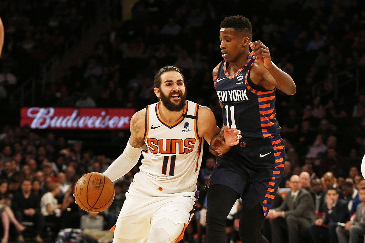 Phoenix Suns guard Ricky Rubio dribbles the ball while being defended by New York Knicks guard Frank Ntilikina during the second half at Madison Square Garden.