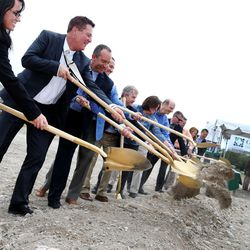 Dignitaries break ground during a ceremony for the future Granger Medical Clinic in West Valley City on Wednesday, Aug. 5, 2015.