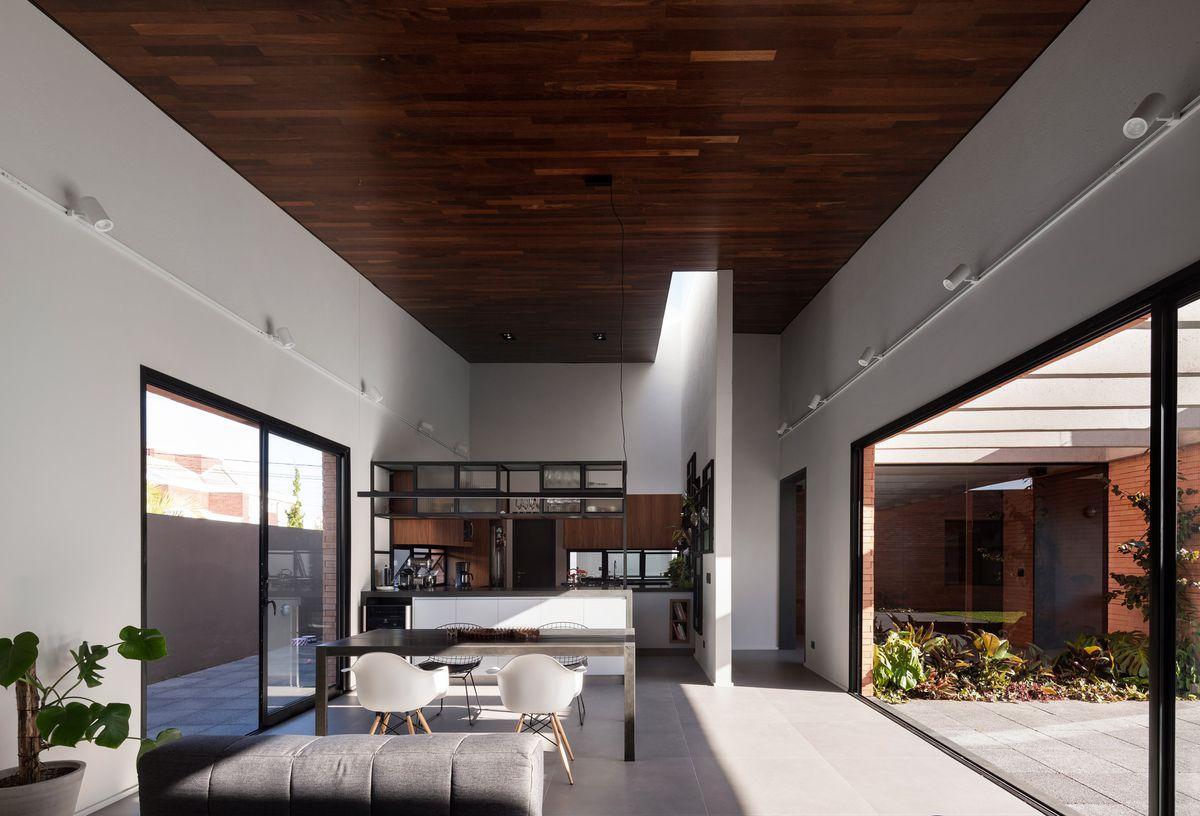 Living room with doors open to courtyard.