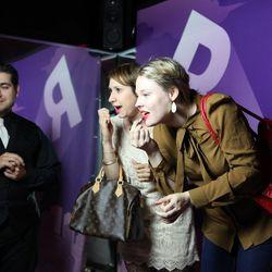 Kat Harris and Sabrina Michaeli check out the flipbook machine.