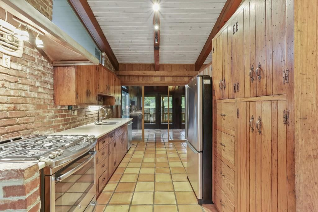 A long kitchen space with a patio beyond.