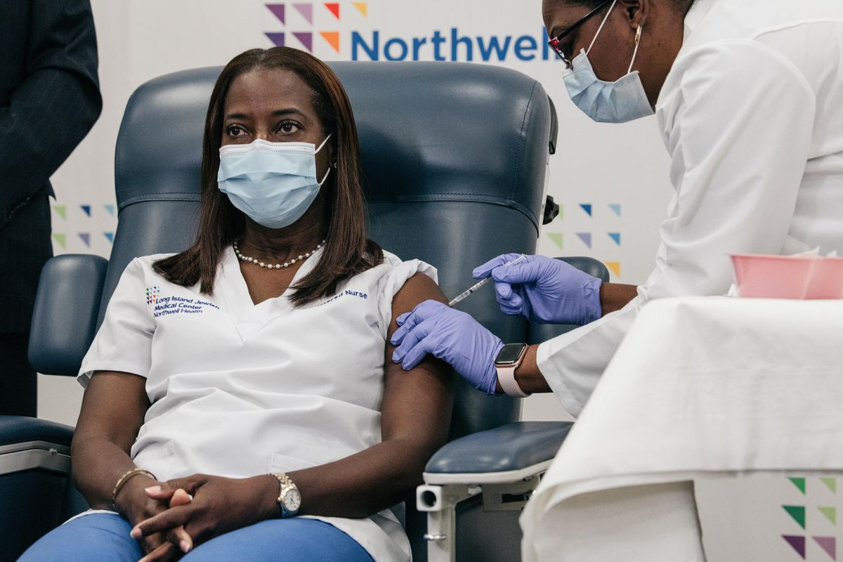 Nurse Sandra Lindsay became the first person in the country to get the coronavirus vaccine after receiving a shot at Long Island Jewish Medical Center, Dec. 14, 2020.