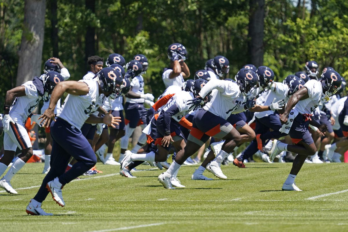 Bears players warm up during a practice session last month.