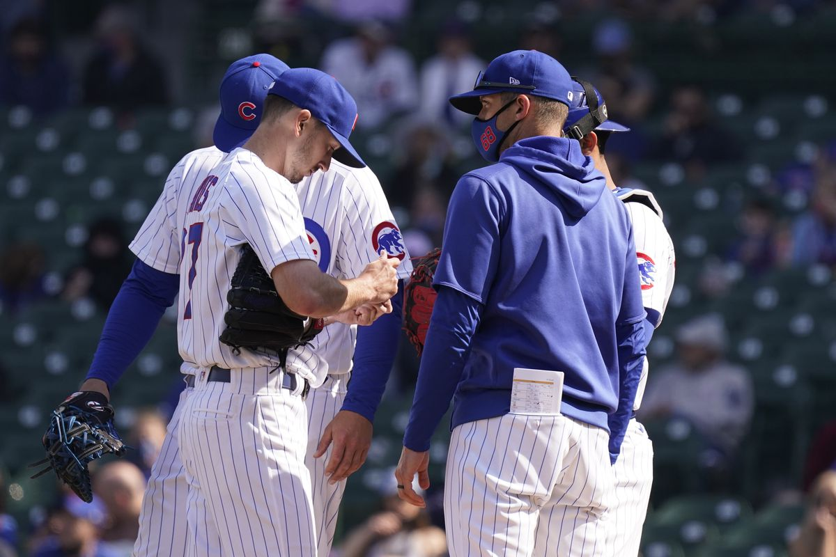 The Cubs' Zach Davies gets a mound visit from pitching coach Tommy Hottovy earlier this season.