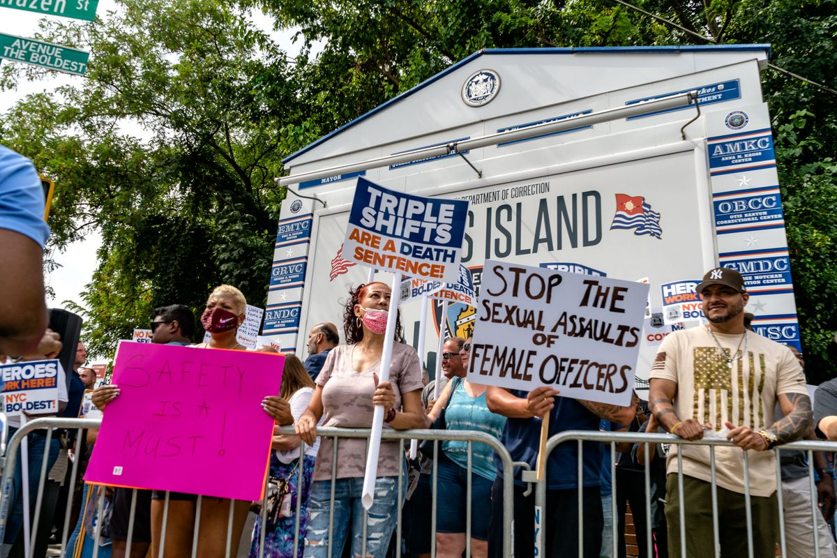Correction officers rally at the Queens entrance to the bridge to Rikers Island on Aug. 16.