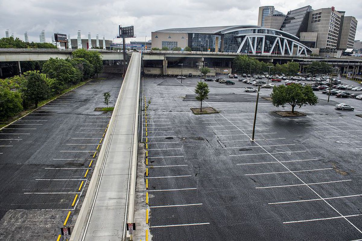 """The Gulch's current parking lots and railroad tracks, where """"Centennial Yards"""" is planned."""