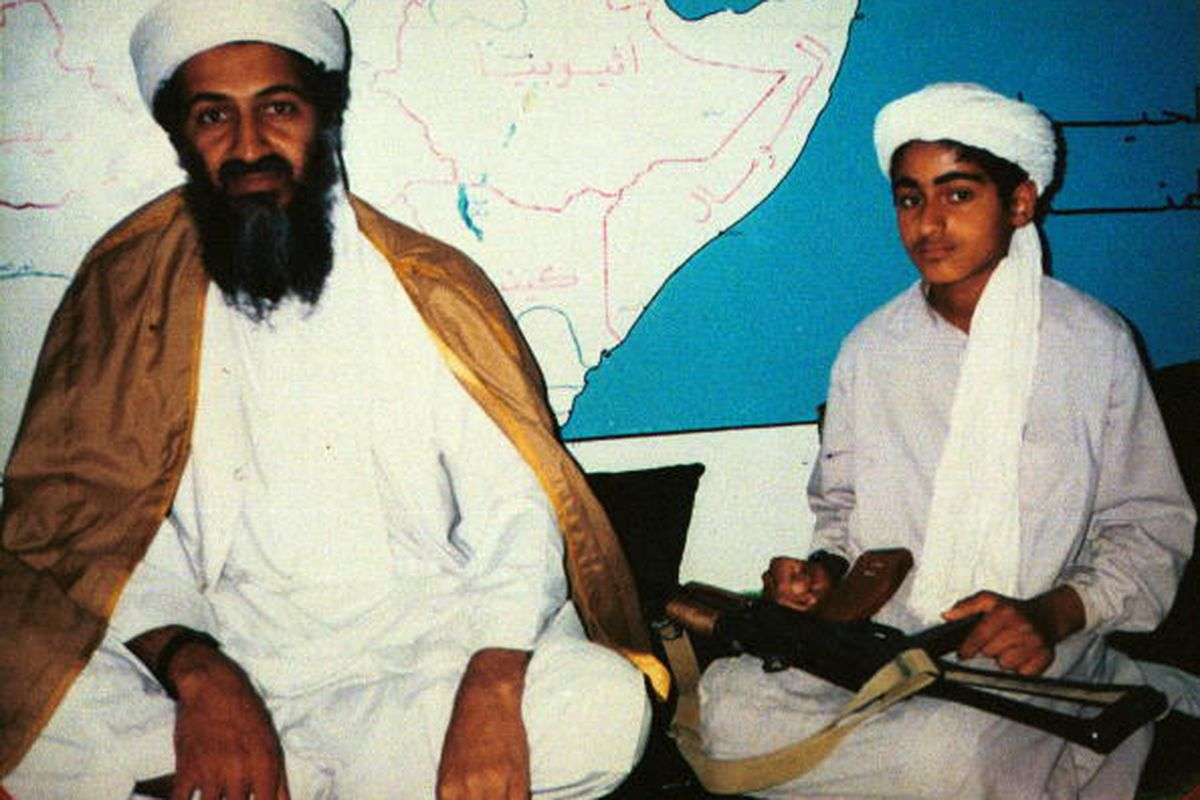 Bin Laden with a son in an undated photo.