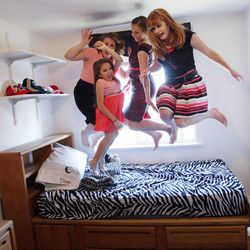 BYU student Kelsey Morasco jumps on the bed with roommates Ashley Mauger, Lindsey Hunt and Breanna Hutchings  in their apartment  in Provo April 29, 2012.