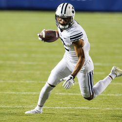 Brigham Young Cougars wide receiver Neil Pau'u (2) runs the ball against the Western Kentucky Hilltoppers defense during an NCAA football game at LaVell Edwards Stadium in Provo on Saturday, Oct. 31, 2020.