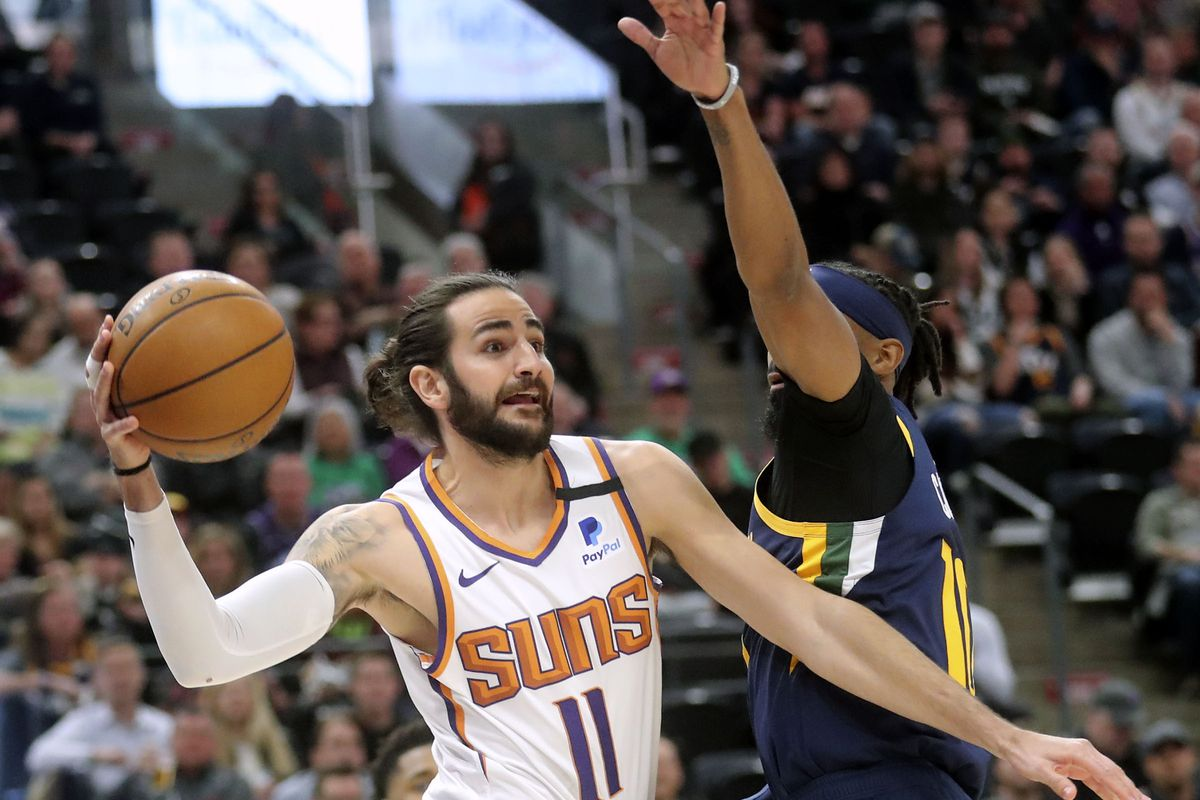 Phoenix Suns guard Ricky Rubio (11) throws the ball around Utah Jazz guard Mike Conley (10) during an NBA game at the Vivint Smart Home Arena in Salt Lake City on Monday, Feb. 24, 2020.
