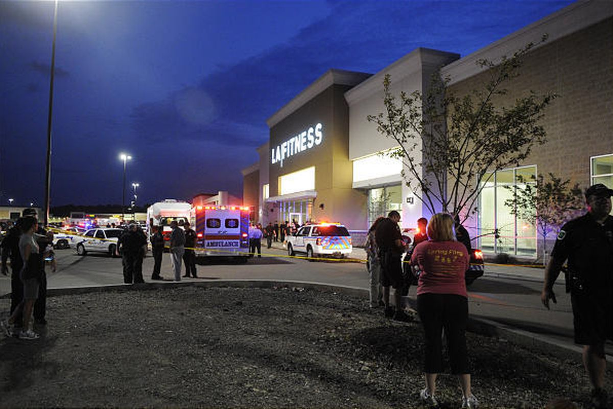 Emergency workers and bystanders are seen outside an LA Fitness location in Bridgeville, Pa. on Tuesday.