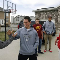 Friends of an Alta High School student who was accused of a racist stunt at school say goodbye after telling their point of view in Draper on Tuesday, March 29, 2011. Victor Villegas is at left front with Nick Allen at center. At right is Adriel Jefferson. In the background are Jack Allen and Ammon Barker.