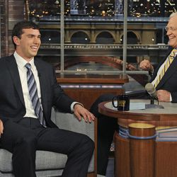 """In this photo provided by CBS, Stanford quarterback Andrew Luck, left, talks with television host David Letterman on the set of """"The Late Show with David Letterman,"""" Thursday, April 26, 2012, in New York."""