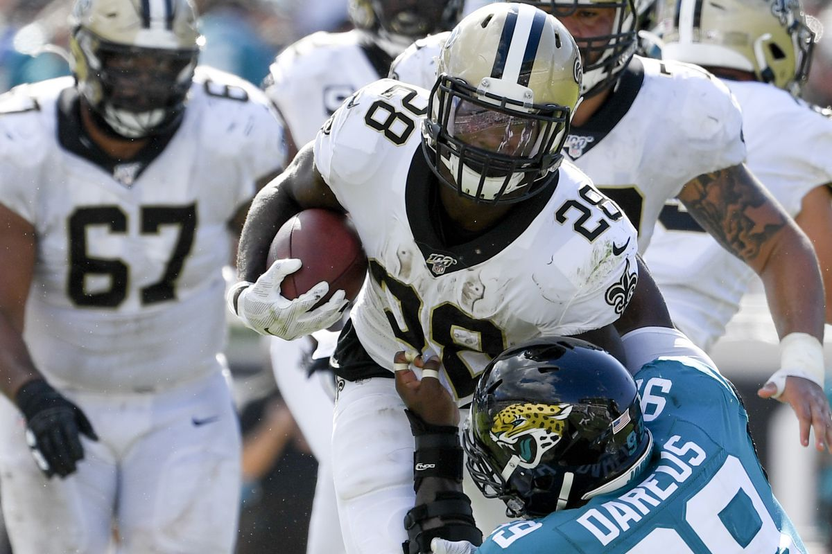 New Orleans Saints running back Latavius Murray runs the ball against Jacksonville Jaguars defensive tackle Marcell Dareus during the fourth quarter at TIAA Bank Field.
