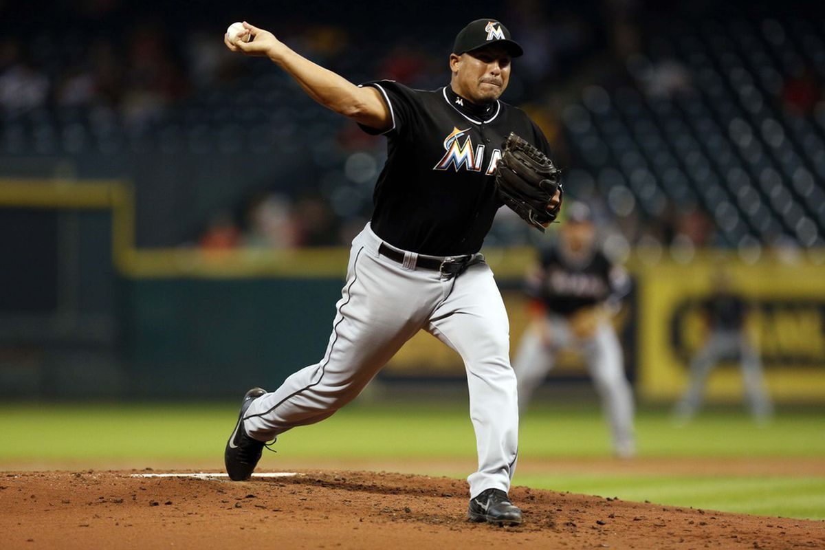 May 7, 2012; Houston, TX, USA; Miami Marlins starting pitcher Carlos Zambrano (38) pitches against the Houston Astros during the third inning at Minute Maid Park. Mandatory Credit: Thomas Campbell-US PRESSWIRE