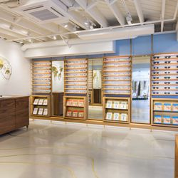 Warby Parker's maritime-inspired corner, which features a world map showcasing every time zone and an antique brass map installation.