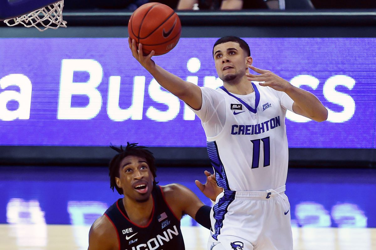 Creighton Bluejays guard Marcus Zegarowski scores against Connecticut Huskies forward Isaiah Whaley in the second half at CHI Health Center Omaha.