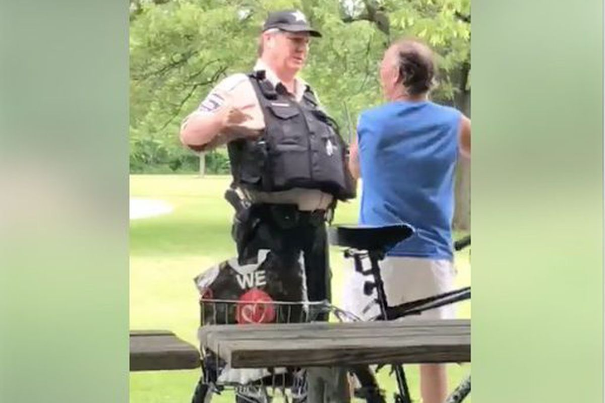 Forest Preserve Officer Patrick Connor talks with Timothy Trybus.