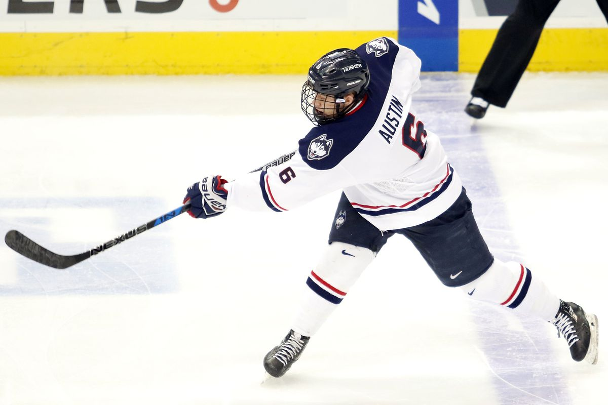 UConn's Johnny Austin (6) shoots the puck on goal. He would finish the night with a goal and two assists in the win.