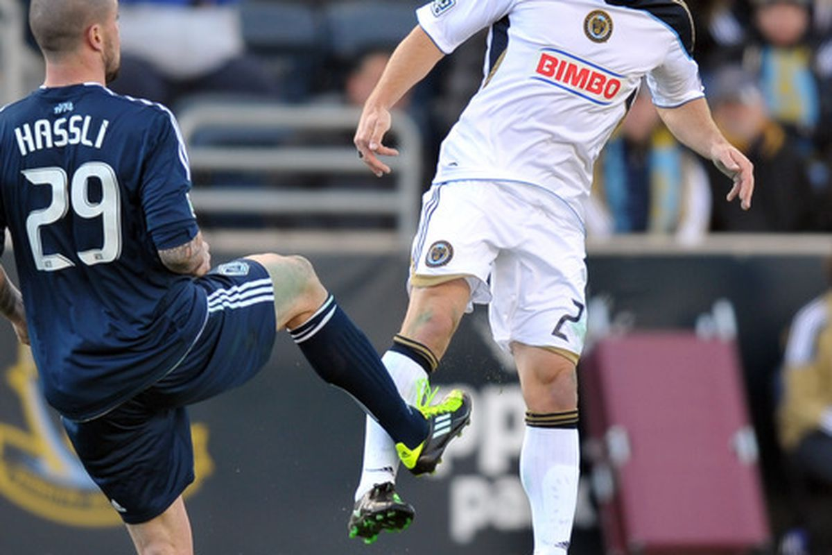CHESTER, PA- MARCH 26: Jordan Harvey #2 of the Philadelphia Union heads the ball past Eric Hassli #29 of the Vancouver Whitecaps at PPL Park on March 26, 2011 in Chester, Pennsylvania. The Union won 1-0. (Photo by Drew Hallowell/Getty Images)