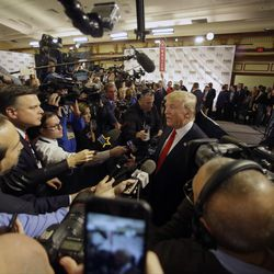 Donald Trump talks to members of the media in the spin room after the Republican presidential debate at the Milwaukee Theatre, Tuesday, Nov. 10, 2015, in Milwaukee.