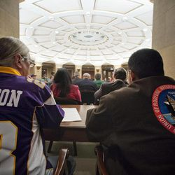 Minnesota Vikings supporter Gene Harris and Joe Navejas of the United Union of Roofers, Waterproofers and Allied Workers listen to testimony in the Senate Jobs and Economic Growth Committee at the state Capitol on Tuesday, April 24, 2012.  The Senate Jobs and Economic Development Committee moved the proposal forward Tuesday on a voice vote. It's due next in the Senate Finance Committee which could be its last stop before a Senate floor vote.  The House version of the $1 billion stadium proposal has cleared committees and could get a floor vote as early as Wednesday.