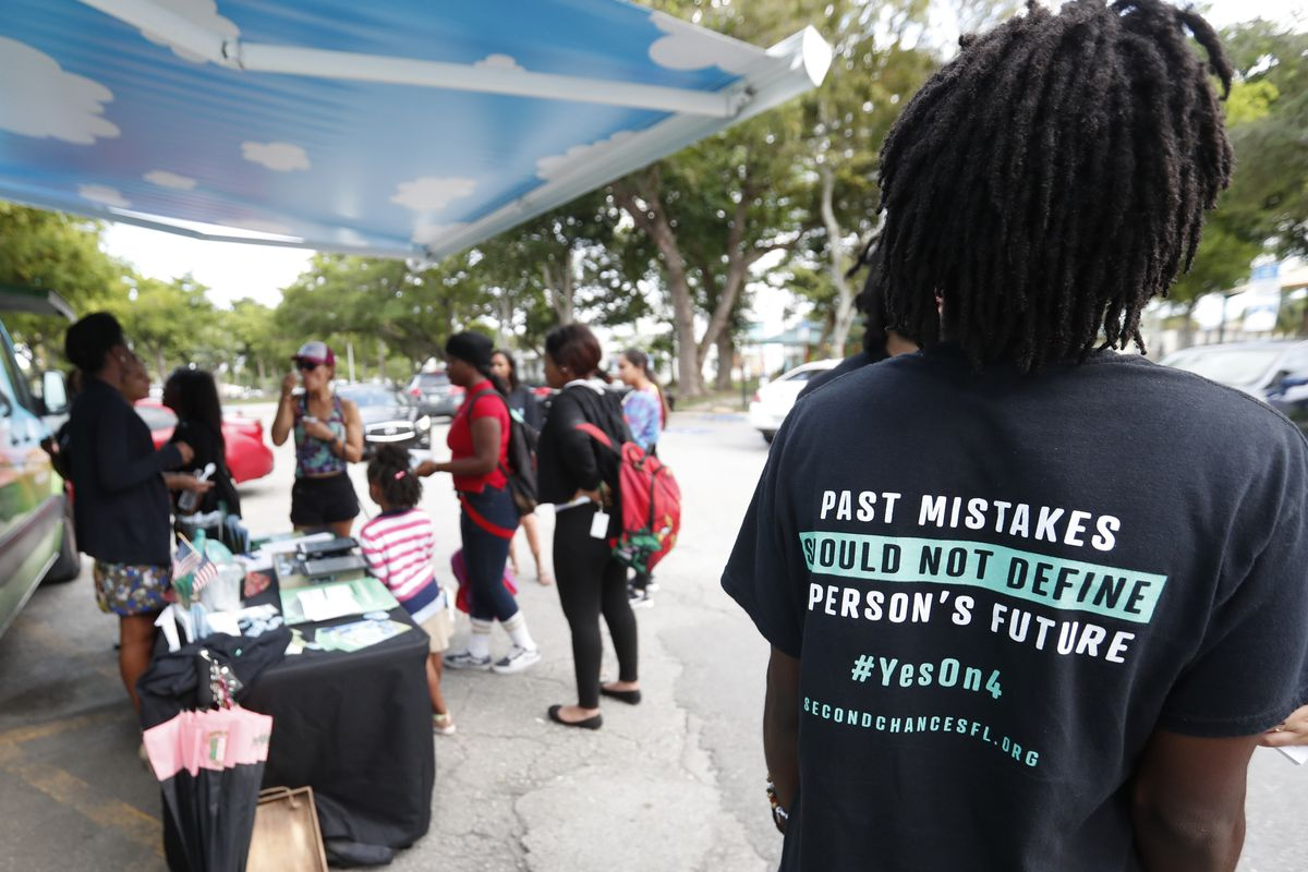 Local activists share information about the Amendment 4 ballot initiative on Oct. 22, 2018. A trio of new lawsuits argue that a new Florida law unconstitutionally  limits how many people can immediately get their voting rights restored.