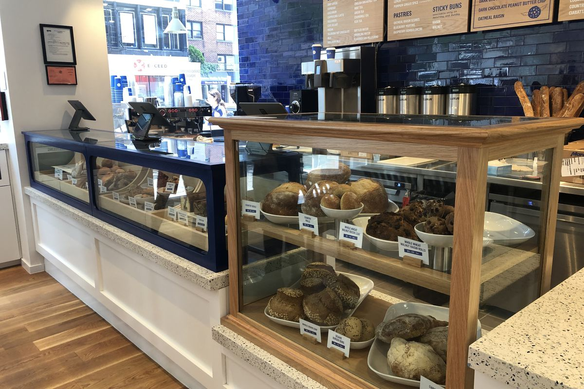 Levain's new Upper East Side bakery counter, a blue and wood glass case filled with pastries