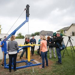 Journalists observe a demonstration of the Village Drill at the home of John Renouard, founder and president of WhoLives, in South Jordan on Friday, Sept. 15, 2017.
