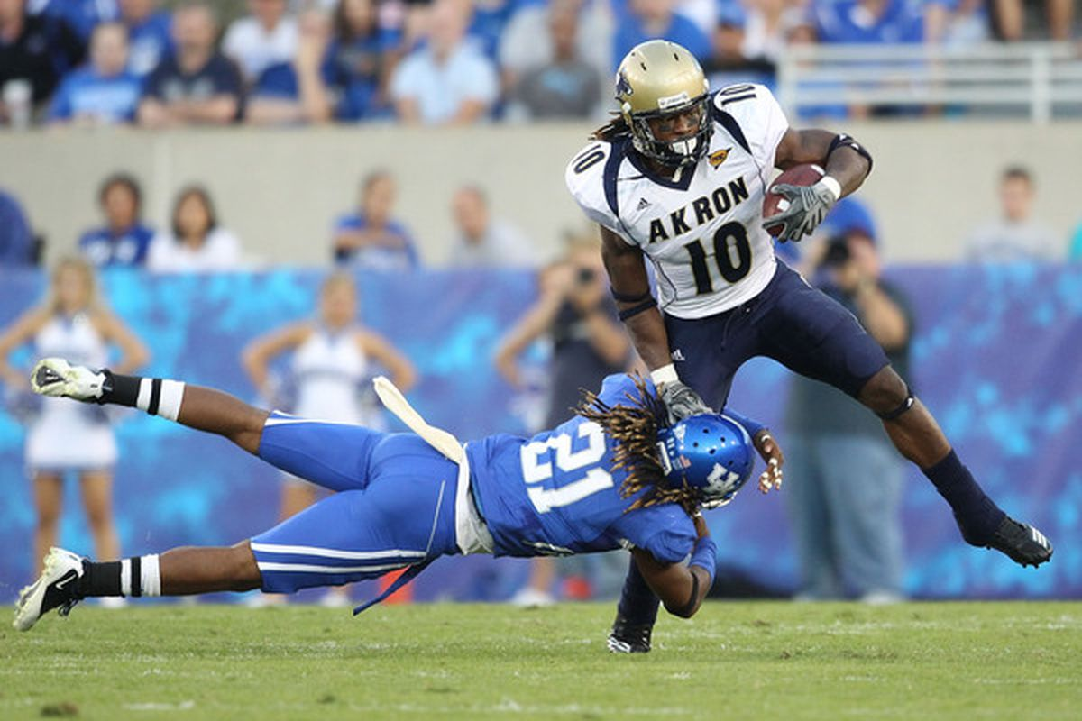 LEXINGTON KY - SEPTEMBER 18: Winston Guy #21 of the Kentucky Wildcats tackles Alex Allen #10 of the Akron Zips during the game  at Commonwealth Stadium on September 18 2010 in Lexington Kentucky.  (Photo by Andy Lyons/Getty Images)