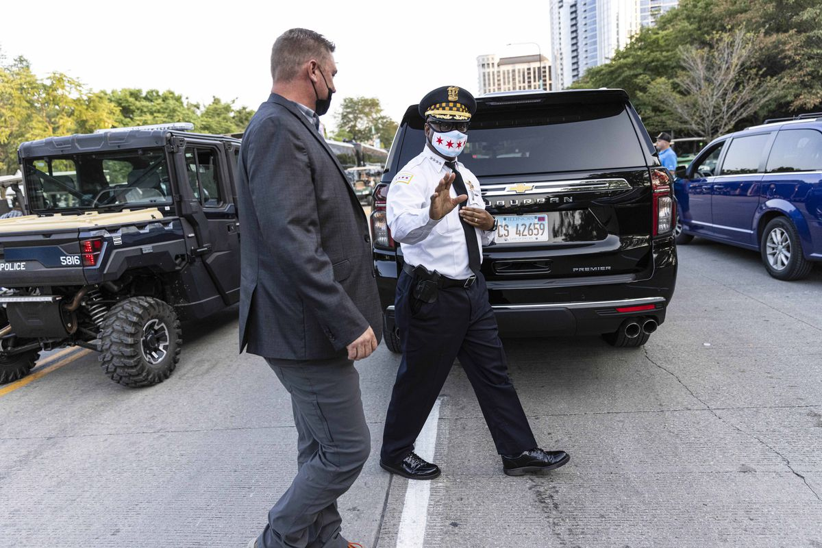 Chicago Police Supt. David Brown walks back to his vehicle on day four of Lollapalooza in Grant Park.