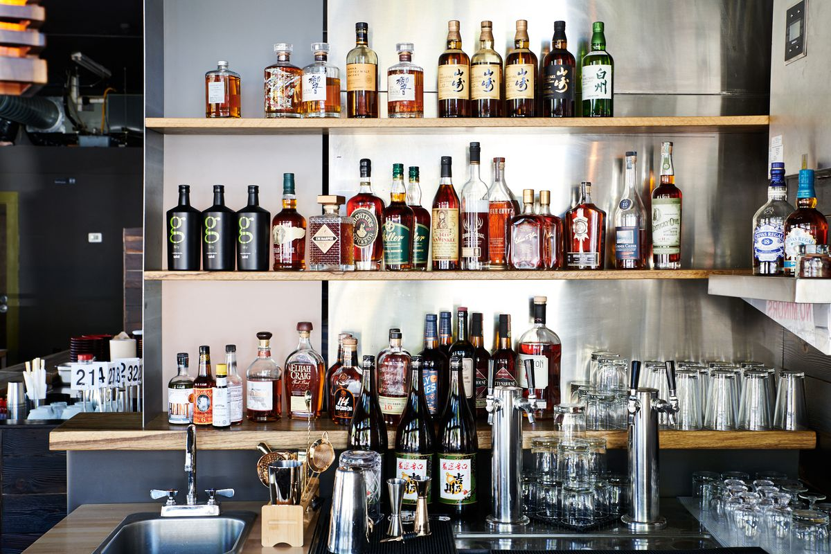 A back bar lined with whiskey at Hapa