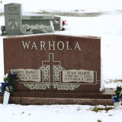 A headstone marking the graves of James Warhola, 8, and Jean Marie Warhola, 7, is pictured at Lindquist Memorial Park in Layton on Wednesday, Jan. 29, 2020. Prosecutors say the children were strangled by their mother more than nine years ago.
