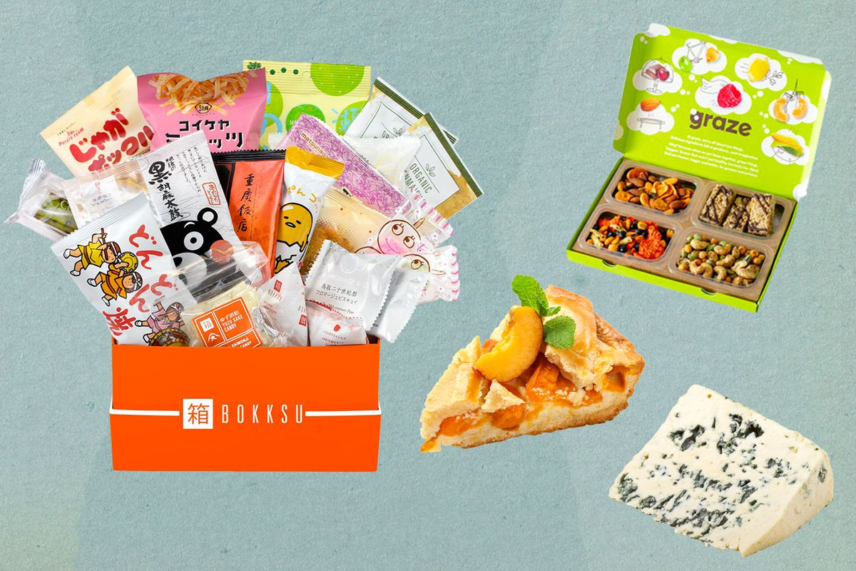 An open Bokksu box, Graze box, and slice of pie and slice of cheese.