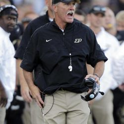 Purdue head coach Danny Hope yells to his team during the second half of an NCAA college football game against Marshall in West Lafayette, Ind., Saturday, Sept. 29, 2012. Purdue defeated Marshall 51-41.