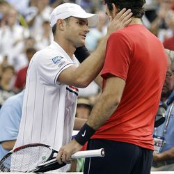 Andy Roddick, left, greets Argentina's Juan Martin Del Potro after their match in the quarterfinals during the 2012 US Open tennis tournament,  Wednesday, Sept. 5, 2012, in New York. Roddick, who lost to Del Potro, said he would retire after the match. (AP Photo/Darron Cummings)