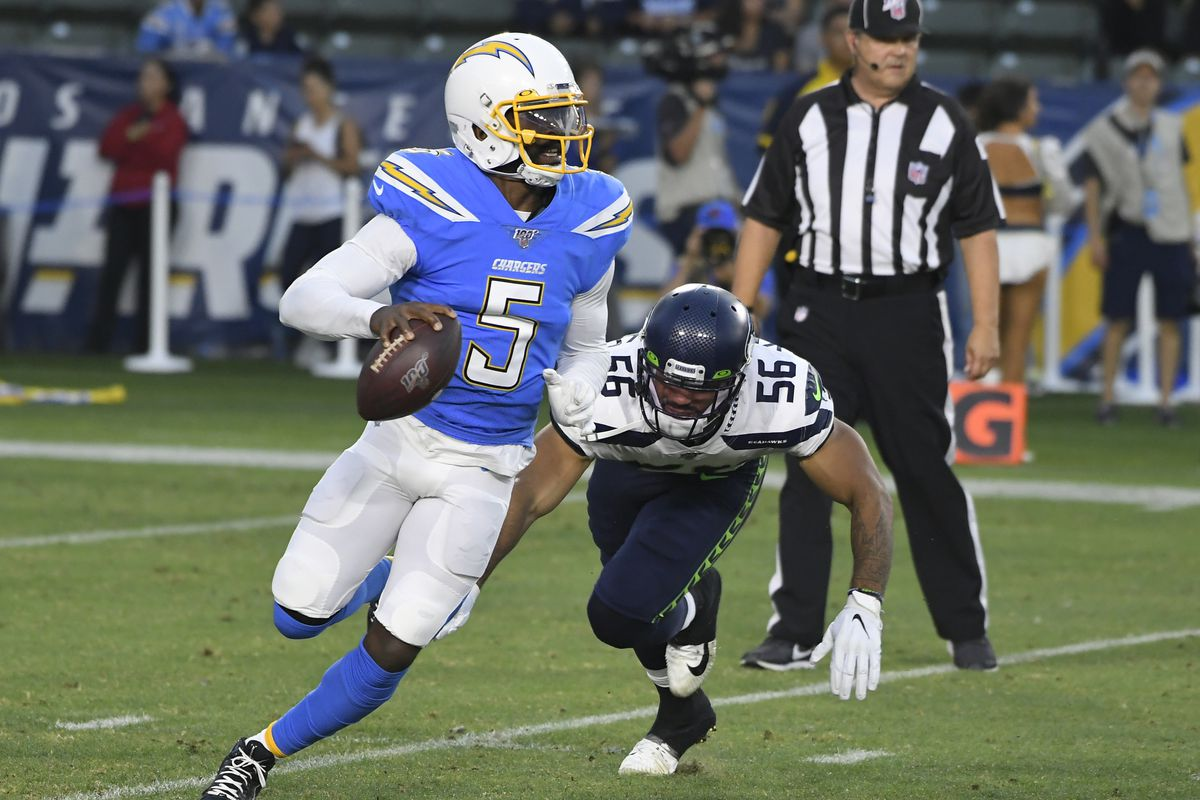 Tyrod Taylor #5 of the Los Angeles Chargers avoids Mychal Kendricks #56 of the Seattle Seahawks during a preseason NFL football game at Dignity Health Sports Park on August 24, 2019 in Carson, California. The Seattle Seahawks won 23-15.