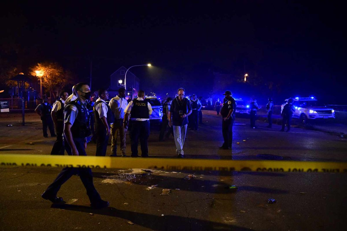 Police investigate after eight people were shot, four of them fatally, July 4, 2020, in the 6100 block of South Carpenter Street.