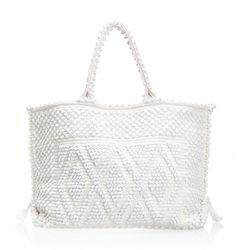 Italian brand Antonello makes cute, colorful pom pom handbags and totes with eco-friendly fabric from Sardinia. Go with the extra-large tote for the perfect beach bag-meets weekender.