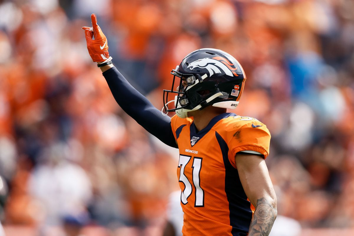 Denver Broncos safety Justin Simmons gestures in the first quarter against the Chicago Bears at Empower Field at Mile High.
