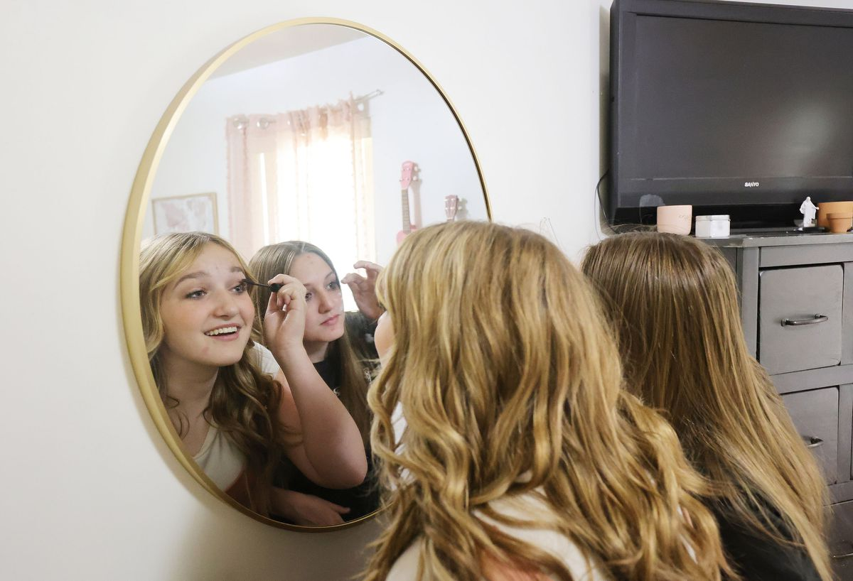 Lydia Moffitt, 14, left, puts on makeup with friend Prezlee Miner at Moffitt's home in Grantsville on Friday, May 21, 2021. Jamie Moffitt, Lydia's mother, decided to teach her children about safety and responsibility and then trust them to have a childhood.
