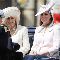 In a custom Alexander McQueen coat, Jane Corbett hat, and Annoushka pearl earrings for 2013's Trooping The Colour ceremony.