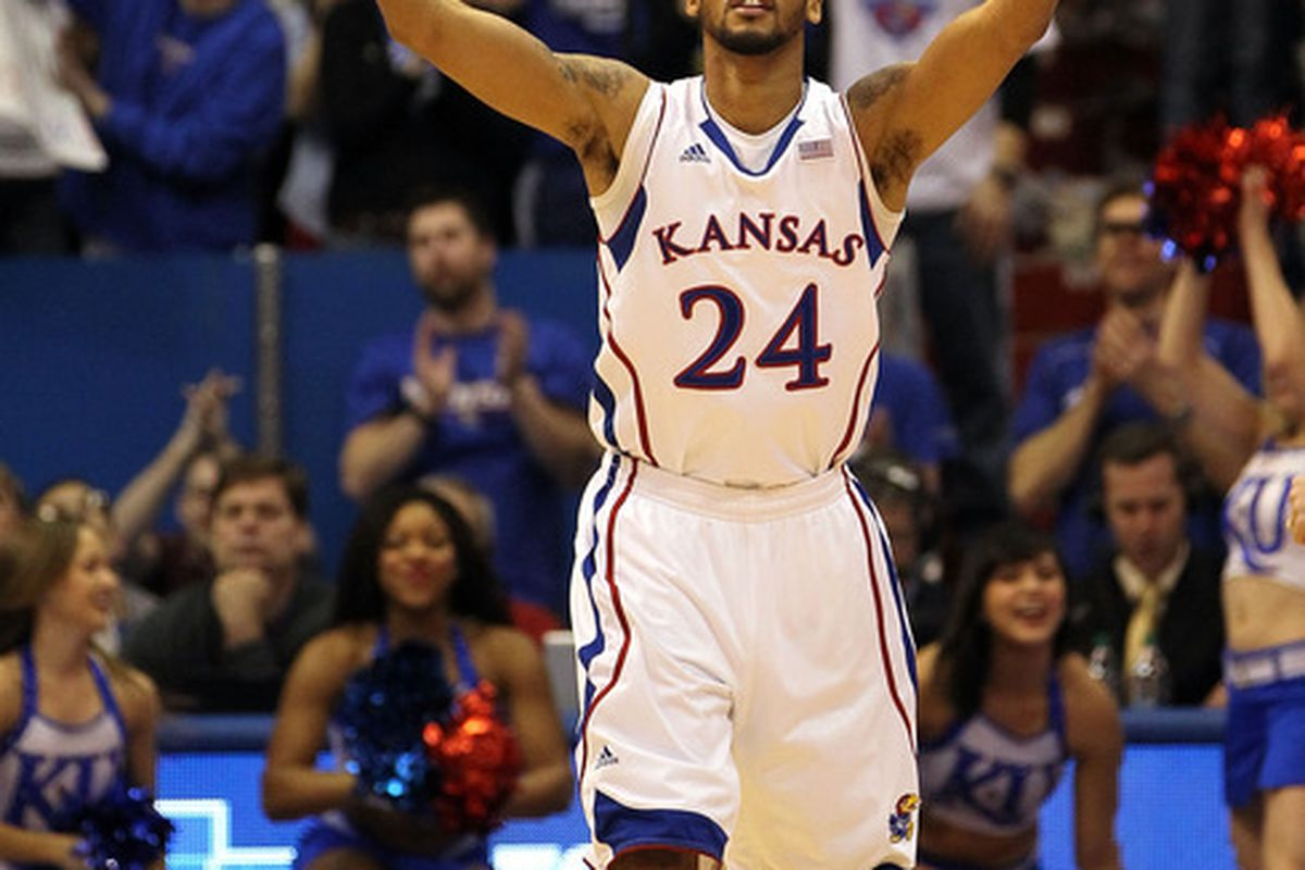LAWRENCE, KS - FEBRUARY 01:  Travis Releford #24 of the Kansas Jayhawks reacts after scoring during the game against the Oklahoma Sooners on February 1, 2012 at Allen Fieldhouse in Lawrence, Kansas.  (Photo by Jamie Squire/Getty Images)