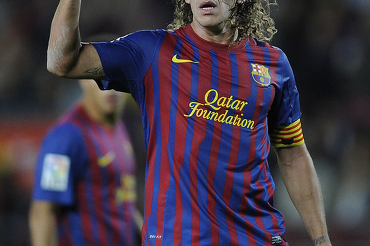 BARCELONA, SPAIN - OCTOBER 15:  Carles Puyol of FC Barcelona reacts during the La Liga match between FC Barcelona and Real Racing Club at Camp Nou on October 15, 2011 in Barcelona, Spain. Barcelona won 3-0.  (Photo by David Ramos/Getty Images)