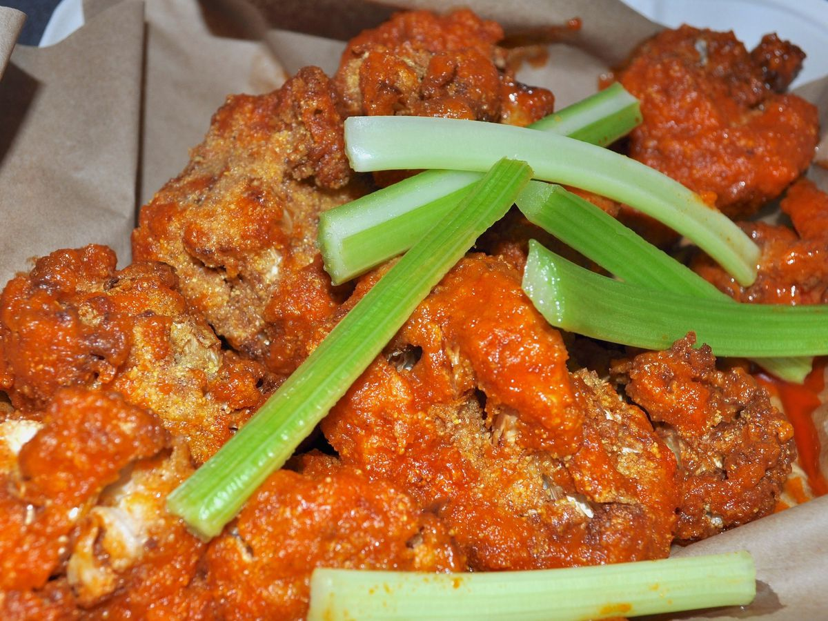 Fried cauliflower with buffalo sauce and celery