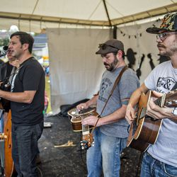 Ian Newberry (right) performs on the main stage with the Smokey's Farmland Band during Chomp & Stomp.